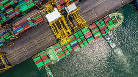 Container ship loading and unloading in deep sea port, Aerial top view of logistic import export transportation business by royalty free stock photography