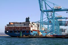 Container ship Maersk Sarat working with containers cranes. Stock Images