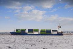 Container ship. Medium container ship sailing after leave port Stock Photography