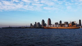 A container ship moves into San Diego harbor stock video footage