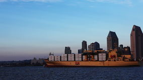 Container ship moving into San Diego harbor stock video footage