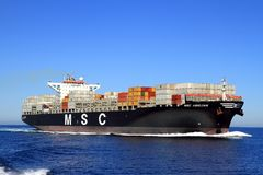 Big container ship MSC ABIDJAN sailing in open waters. Stock Image