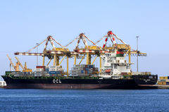 Container ship at Mutrah port. Muscat, Oman - March 26, 2013: Container ship in Mutrah Port Stock Photography