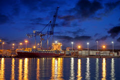 Container ship at night Stock Photo