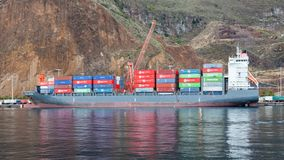 Container Ship Nordluchs Docked in Santa Cruz. The container ship Nordluchs is pictured docked in Santa Cruz on the Spanish island of La Palma Stock Photo