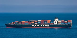Container ship NYK Argus on the high seas.  East (Japan) Sea. Pacific Ocean. 27.05.2014. Far East of Russia. East (Japan) Sea Royalty Free Stock Photo