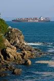 Container ship NYK Argus runs along the green coast. Nakhodka Bay. East (Japan) Sea. 27.05.2014 Stock Images