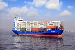 Container Ship OS YOUSR Fully Charged And Anchored. Stock Photo