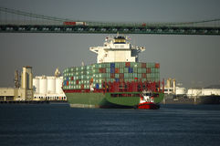Container Ship Passes Under Bridge Royalty Free Stock Images