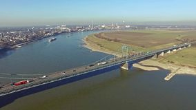 Container ship passing the bridge between Krefeld and Duisburg aerial time lapse stock video