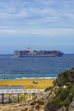 Container ship with people nearby in Victoria, Australia. Stock Photos