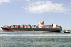 container ship and pilot boat royalty free stock images