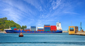 Container ship with pilot boat Stock Images