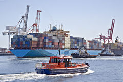 Container Ship and Pilot Cutter Stock Photos