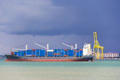 Container Ship in Port. Image of a container ship loading at Butterworth Port, Penang, Malaysia royalty free stock images