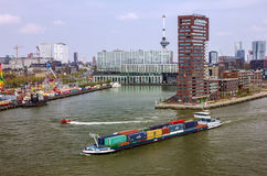Container ship in port area of Rotterdam, Netherlands Royalty Free Stock Image