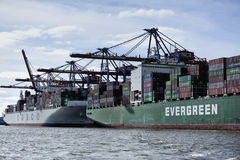 Container ship at the Port of Hamburg (Hamburger Hafen),Germany. HAMBURG, GERMANY - 22 MARCH 2015: Container ship at the Port of Hamburg (Hamburger Hafen) is a Royalty Free Stock Photo