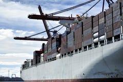 Container ship at the Port of Hamburg (Hamburger Hafen),Germany. HAMBURG, GERMANY - 22 MARCH 2015: Container ship at the Port of Hamburg (Hamburger Hafen) is a Stock Image