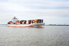 Container ship on river Elbe Stock Photo