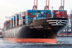 Container ship leaving port Stock Images
