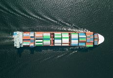 Container ship sailing in sea stock image