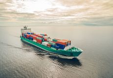 Container ship sailing in sea royalty free stock photos