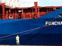 Container ship side view with stevedore operating Stock Image