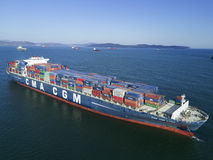 Container ship standing on the roads at anchor. Stock Image