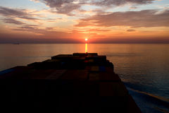 Container ship and sunset Stock Photography