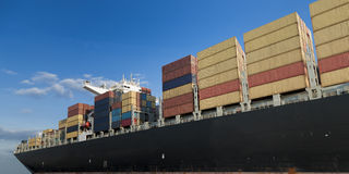 Container ship. Triple- E container ship leaving the port of Antwerp, Belgium Stock Image