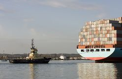 Container ship & tug boat Stock Images