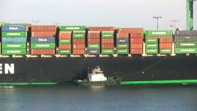 Container ship and tug boat. Video of container ship and tug boat stock video