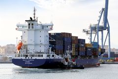 Container ship and tug Royalty Free Stock Images