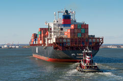 Container Ship and Tug Stock Photography