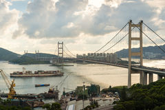 Container ship through under bridge Royalty Free Stock Photo