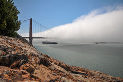 Container ship under the Golden Gate Bridge royalty free stock photos
