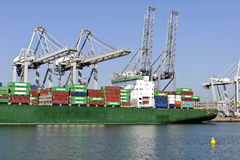 Container Ship Unloading In The Harbor Royalty Free Stock Images