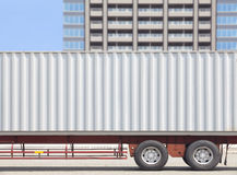 Container shipping truck and high building Royalty Free Stock Photography