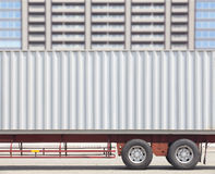 Container shipping truck and high building Stock Image