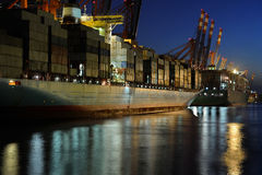 Container ships. At night in hamburg Stock Photo