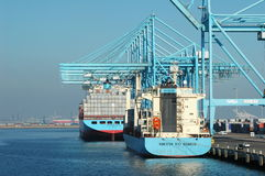 Container ships being unloaded at the dock. Two Containers ships being loaded/unloaded at a dock in Long Beach, California Stock Photography
