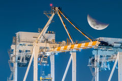 Container Ships Being Unloaded At Night. Royalty Free Stock Photos