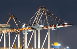 Container Ships Being Unloaded At Night. Stock Photography