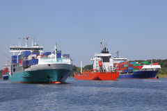 Container ships and a tanker on Kiel Canal Royalty Free Stock Photo