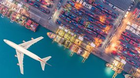 Container ships and transport aircraft in the export and import. Business and logistics international goods. Shipping cargo to harbor by crane. Aerial view and stock images
