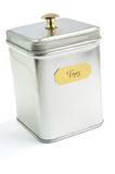 Container for tea. Metal container with lid grey for tea Stock Photo