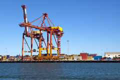 Container Terminal. Viewed from the water, on a clear blue day Stock Image