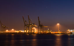 Container terminal. A container terminal in the harbor of Hamburg at night. Two stars in the sky. The lights are reflected by the water of the river Elbe stock photos