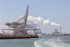 Container terminal with big cranes in Dutch harbor Rotterdam royalty free stock photos