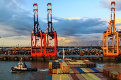Container Terminal in Bremerhaven, Germany. Container vessel approaching the terminal in the port of Bremerhaven, Germany stock photo
